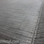 Поверхность биметаллического листа напоминает вспаханное поле Steel Work Кривой Рог